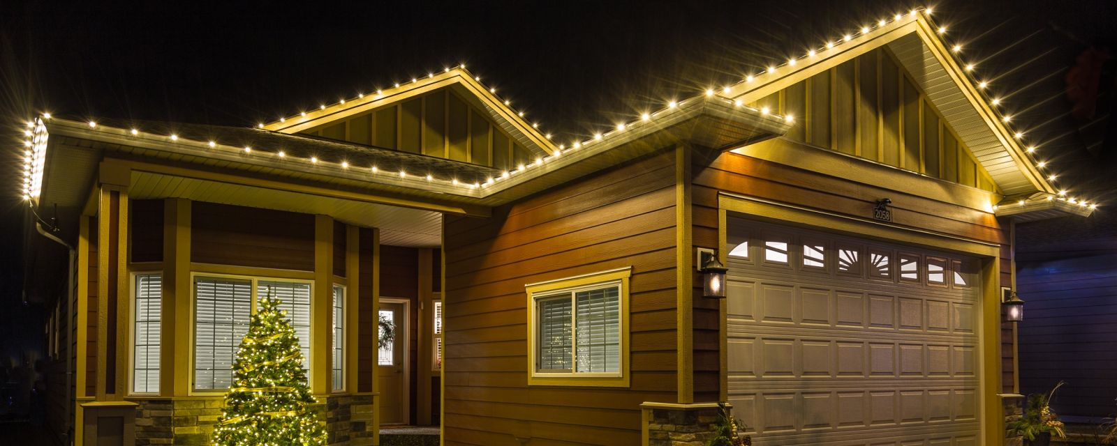 LED Christmas lights along gutters and roof peaks in West Kelowna